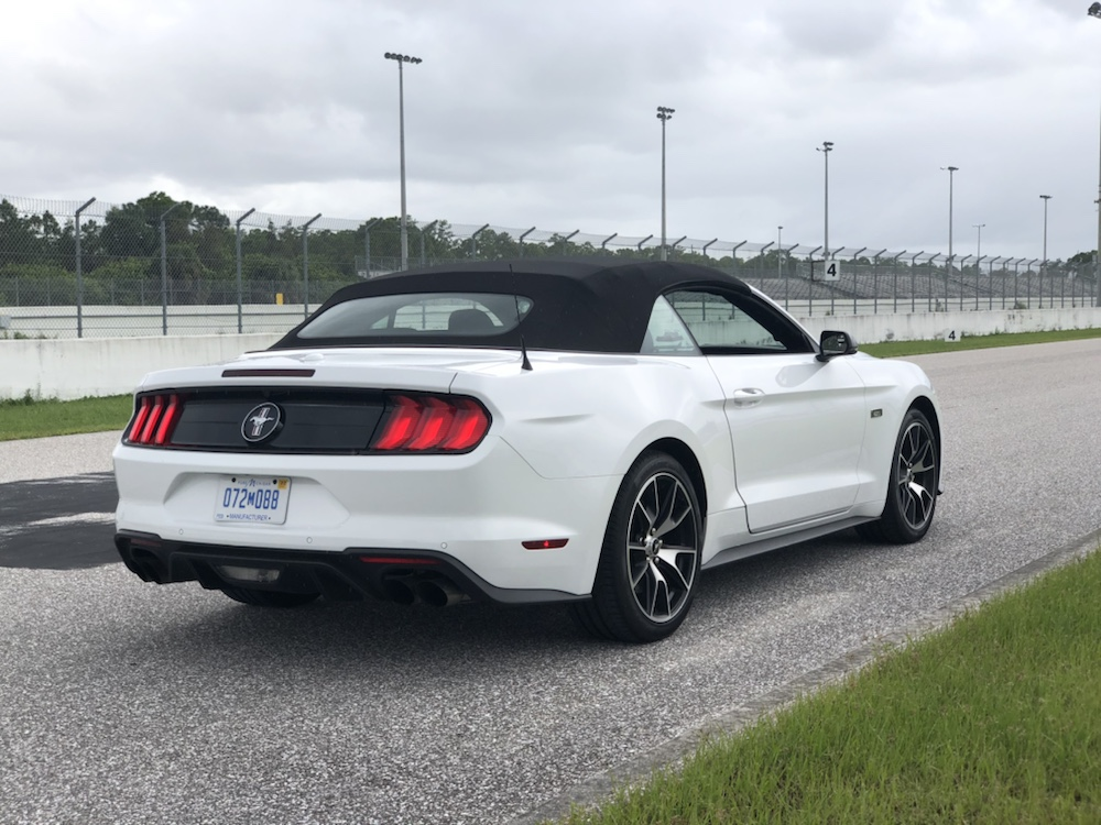 Power Up To The High Performance 2 3l Ford Mustang Convertible Behind The Wheel